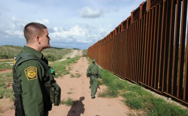 (FILES)US Border Patrol agents Colleen Agle and Richard Funke (L) patrol the border between Arizona and Mexico at the town of Nogales in this July 28, 2010 file photo. Twenty thousand new border patrol agents, hundreds of miles of fencing, billions of dollars in drones, radar and sensors: US lawmakers are proposing a militaristic remedy to staunch illegal immigrant flow from Mexico. The Senate is expected June 24, 2013 to green-light the most important amendment yet to the landmark immigration bill, but the measure -- designed to placate Republican concerns about security -- would ensure that the border region is one of the most highly policed zones in the Western Hemisphere. AFP PHOTO/Mark RALSTON